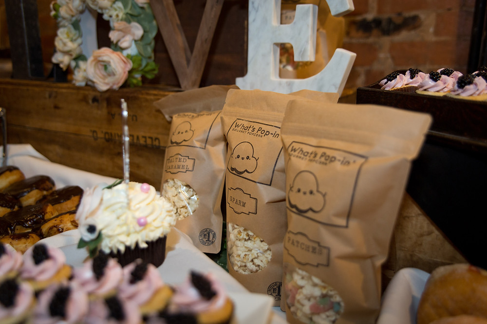 dessert table and favors by Baby Cakes Cupcakery at Buffalo wedding venue Pearl St Grill