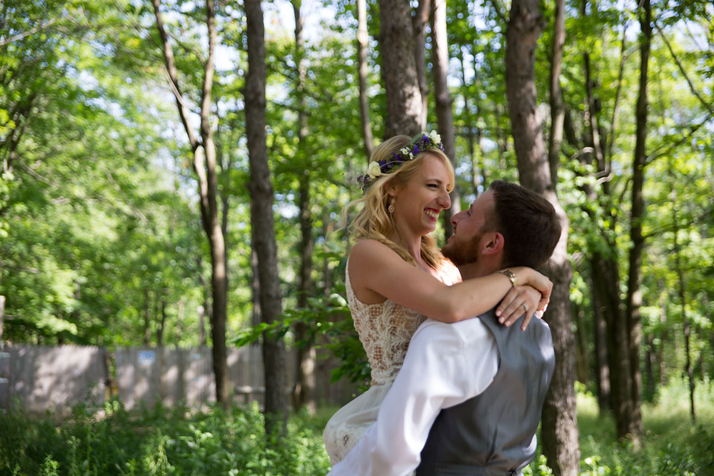 bride and groom laughing photo in the woods at La Esposita Bonita Wedding in Varysburg NY