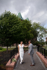 bride and groom dancing outside of buffalo's Hotel Henry