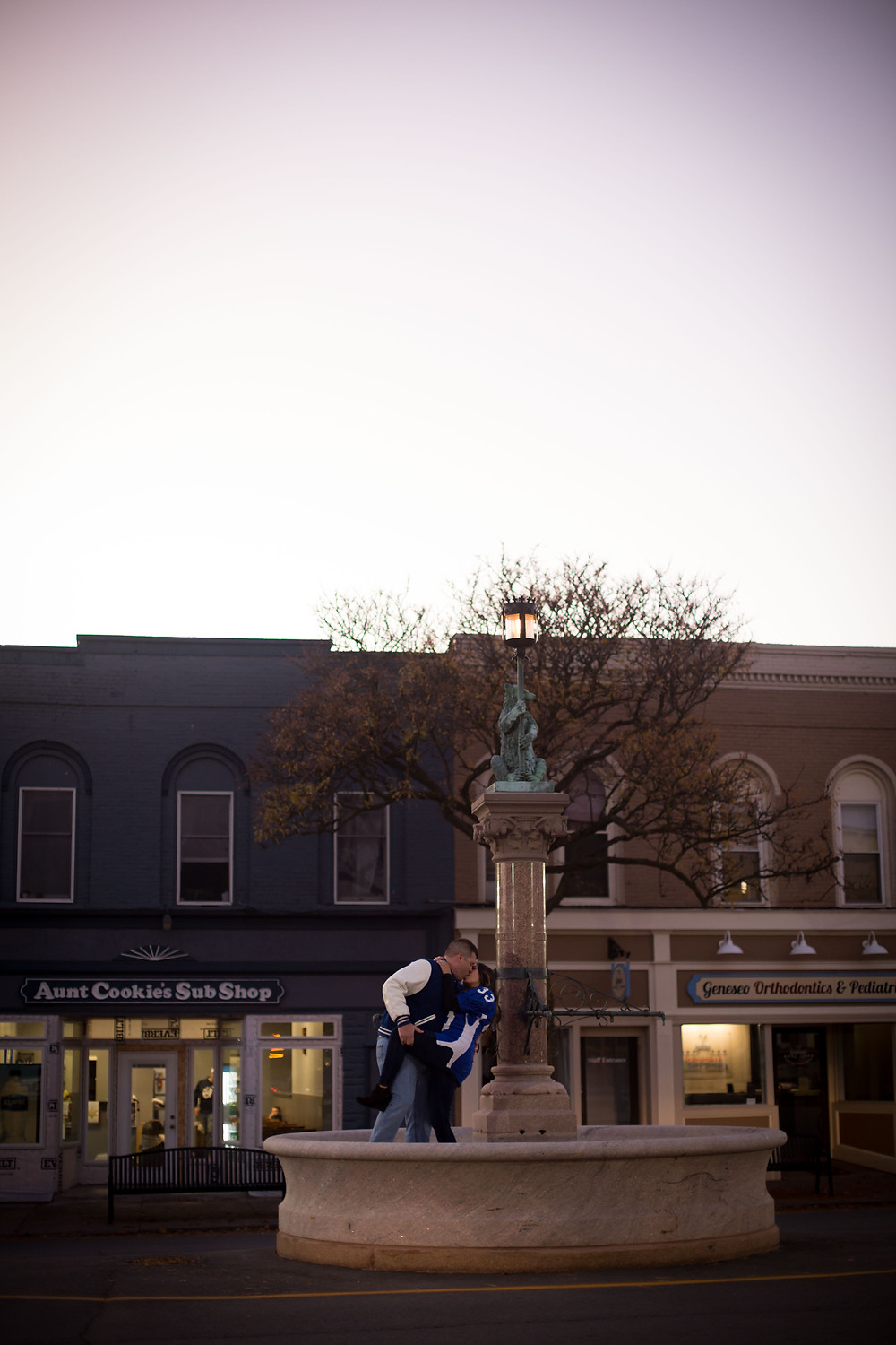 Geneseo NY finger lakes town square fountain high school sweethearts  couples engagement candid photo