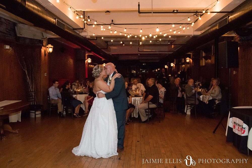 bride and groom's first dance in the Courtyard Room at the Hotel at the Lafayette in Buffalo NY