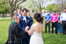 bride and groom exchange vows during intimate wedding ceremony photo at Niagara Falls State Park NY USA