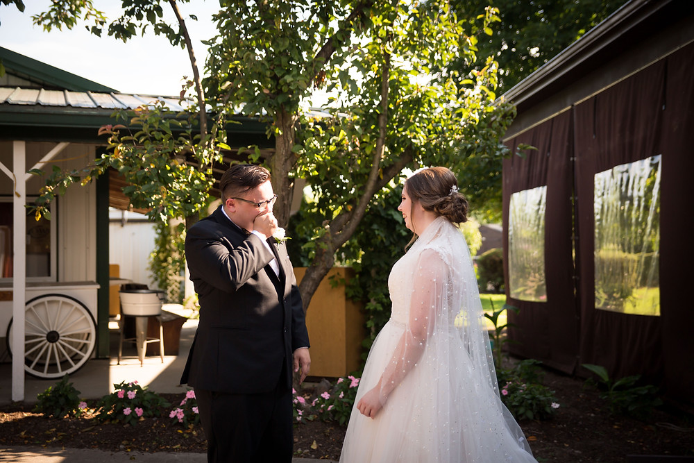 bride and groom first look at Becker Farms Vizcarra Vineyards Gasport NY intimate wedding elopement