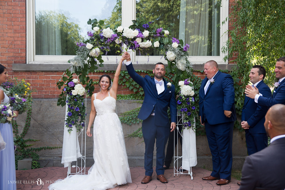 intimate emotional wedding ceremony in Mansion on Delaware courtyard in Buffalo NY