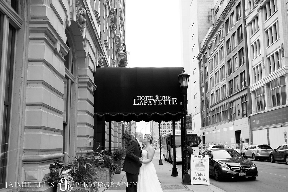 bride and groom kissing photo outside their Hotel Lafayette wedding