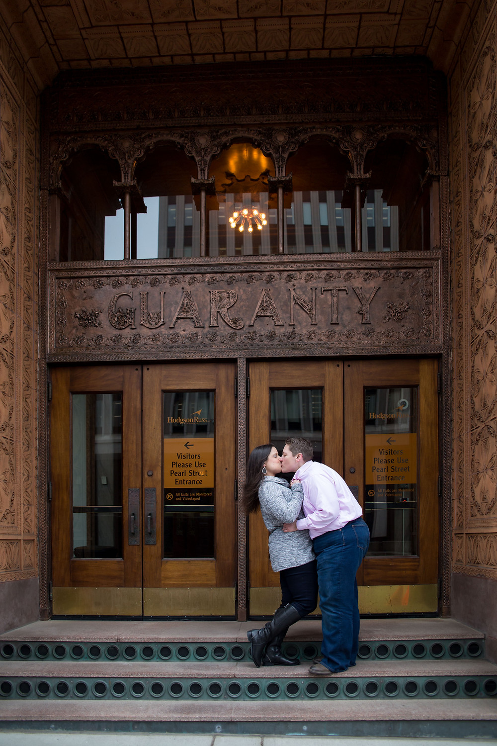 same sex couple outside the Guarantee building in downtown Buffalo NY for their engagement session
