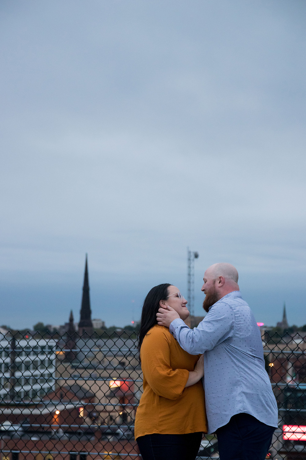 downtown Buffalo rooftop engagement photo