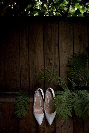 brides shoes with ferns - dark and moody wedding details