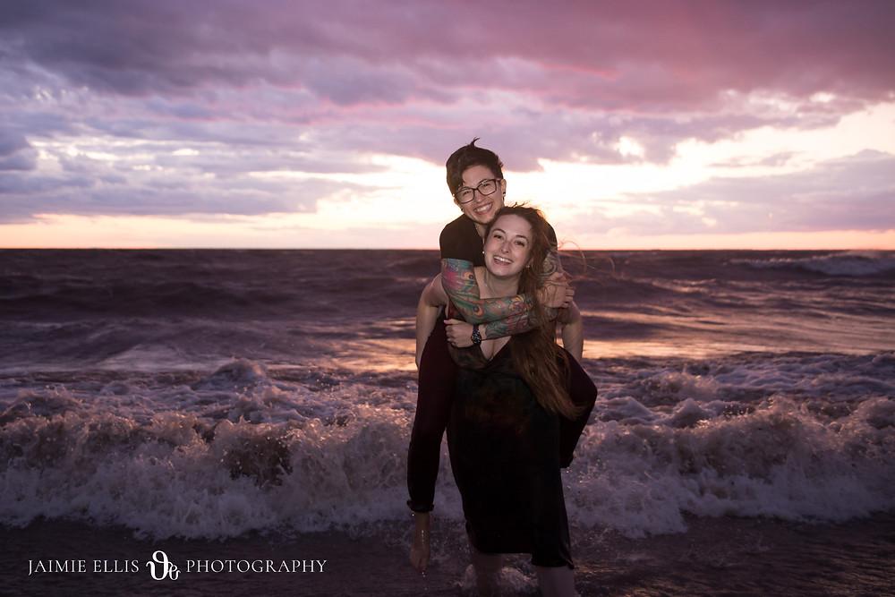 sunset beach engagement photo of lgbt same sex wedding couple Buffalo NY