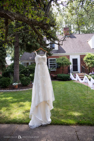 bride's dress outside childhood home bridal detail photo
