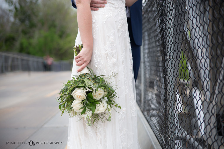 brides bouquet and chain link fence at Niagara Falls State Park NY USA