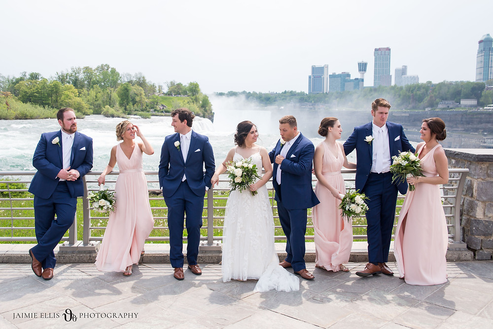 wedding party hanging out with bride and groom at Niagara Falls State Park NY USA photo