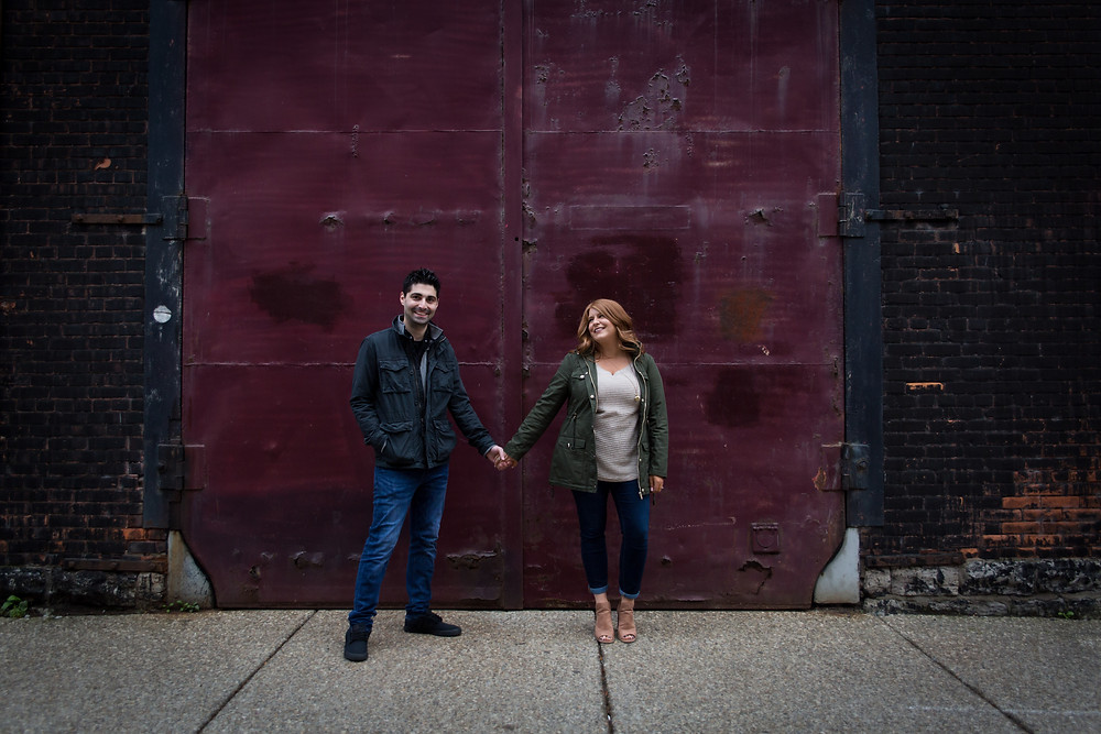 candid cobblestone district Buffalo couples photo shoot engagement session