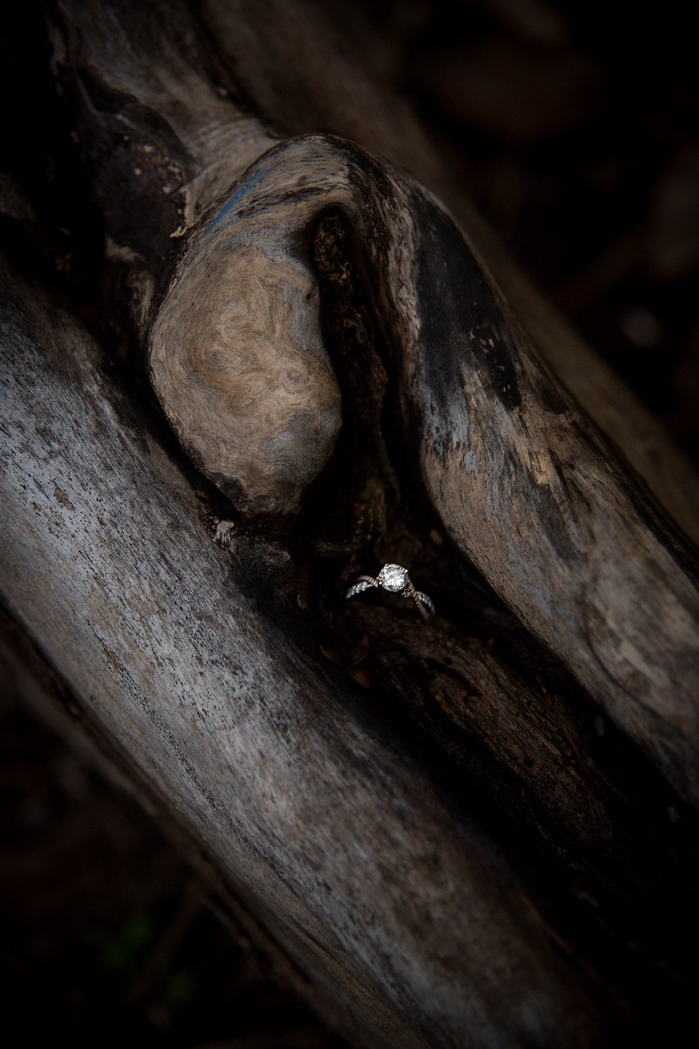 diamond engagement ring on wood