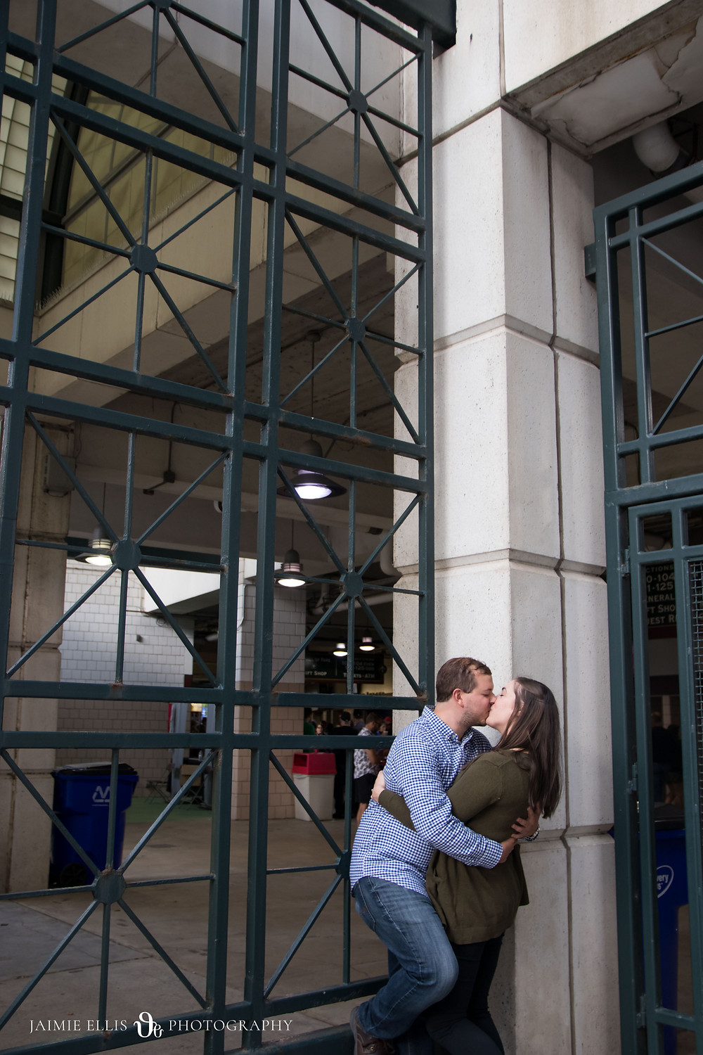 couple kissing outside Sahlen Field Buffalo NY for a Bisons Baseball game engagement session
