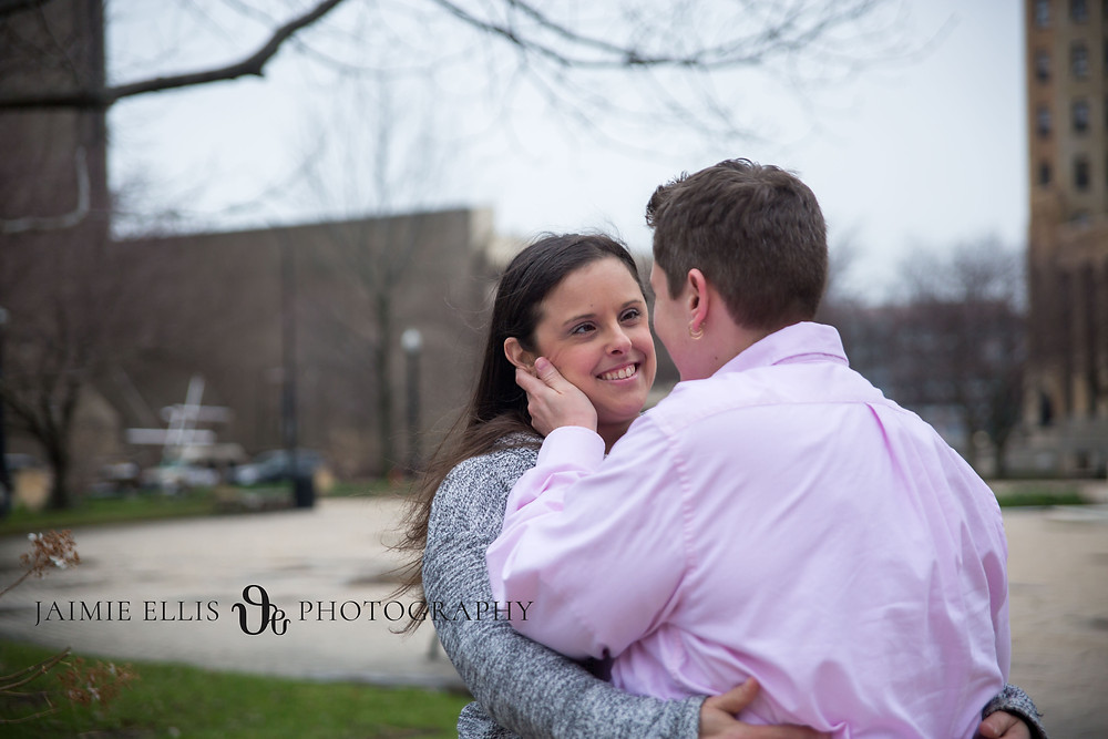same sex couple outside City Hall in downtown Buffalo NY for their engagement session