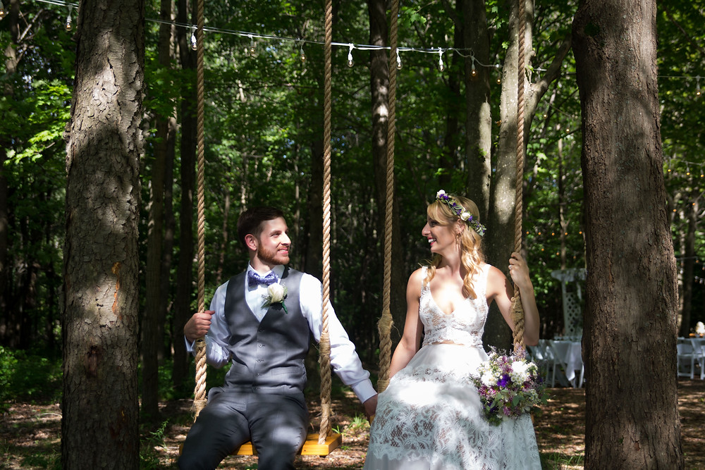 bride and groom photo on the swing in the woods at La Esposita Bonita Wedding in Varysburg NY