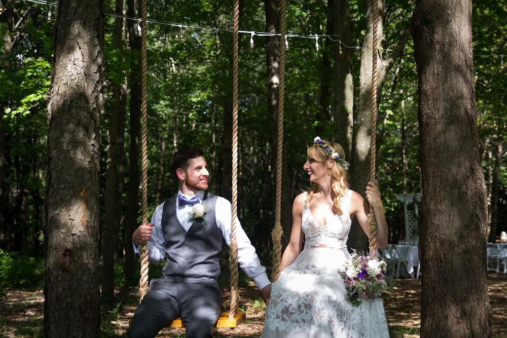 bride and groom photo on the swing in the woods at La Esposita Bonita Wedding in Varysburg NY