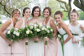 bride with bridesmaids and flower girls after wedding at Niagara Falls State Park NY USA photo
