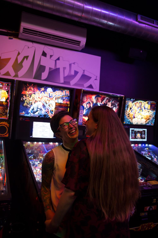 Misuta Chows pinball arcade engagement photo same sex wedding photographer Buffalo NY