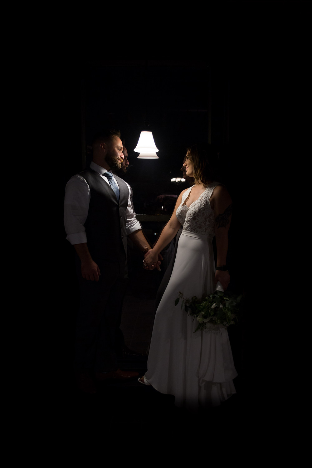 dark and moody bride and groom wedding photo inside Buffalo's Pearl St Grill
