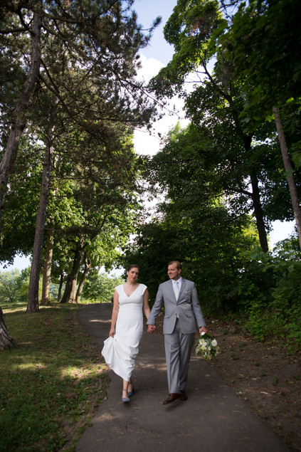 bride and groom walking through Delaware Park in Buffalo