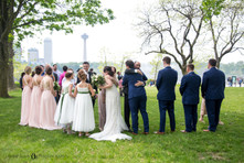 bride and groom hug family after intimate wedding ceremony at Niagara Falls State Park NY USA
