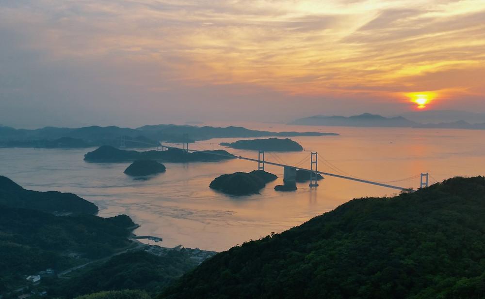Sunset over the Kurushima-Kaikyō Bridge from the Kiro-san Observatory on Ōshima