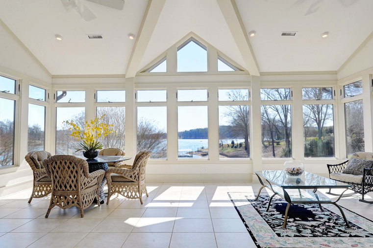 Sun Room with Large Windows Overlooking
