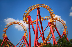 A Colorful Looping Roller Coaster On A B