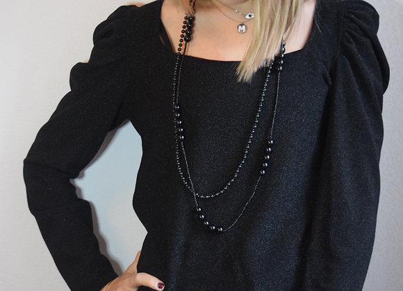 Haut noir à paillettes et son collier
