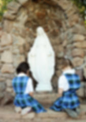 St. Nicholas Students pray in the Mary Grotto. St. Nicholas provides a faith based education. St. Nicholas is a Catholic private school serving Los Altos, Mountain View, Los Altos Hills, Sunnyvale, Cupertino, and Palo Alto.