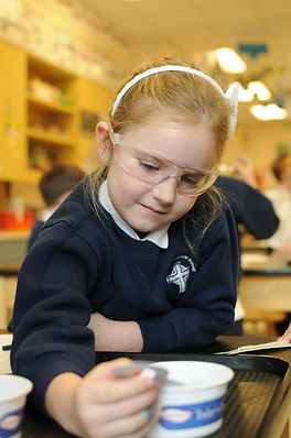 A young girl doing a science experiment. St. Nicholas School has a strong STEM program and low tuition.  St. Nicholas is a Catholic private school serving Los Altos, Mountain View, Los Altos Hills, Sunnyvale, Cupertino, and Palo Alto.