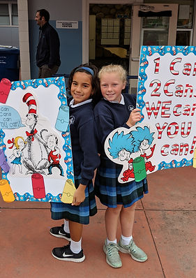4th graders help to run our canned food drive, part of our outreach programs.