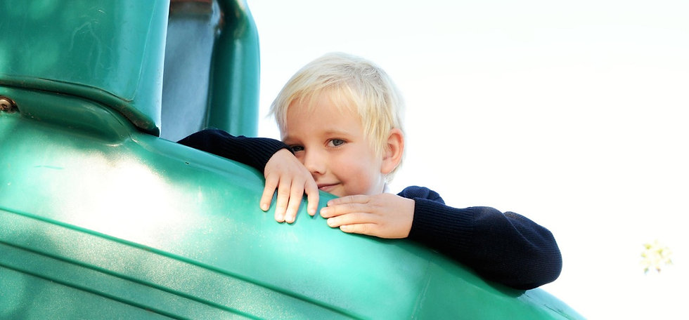 A student plays on a slide on St. Nicholas School's 17 acre campus, with room to run and play. St. Nicholas is a Catholic private school serving Los Altos, Mountain View, Los Altos Hills, Sunnyvale, Cupertino, and Palo Alto.