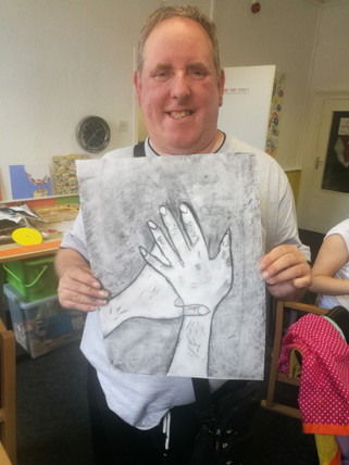 Gary Lee with his Charcoal Drawing