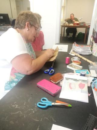 Carol helping Jill learn new skills