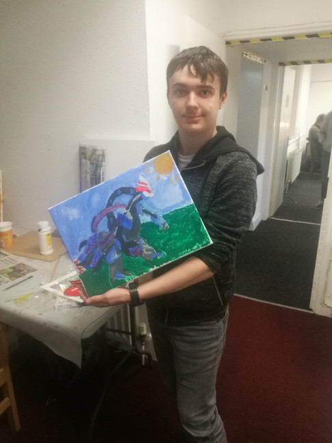 James posing for a photo with his Pokemon Painting