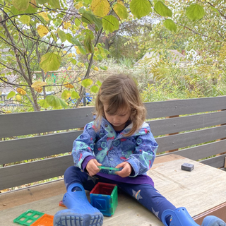 Eleanor building houses with magnatiles