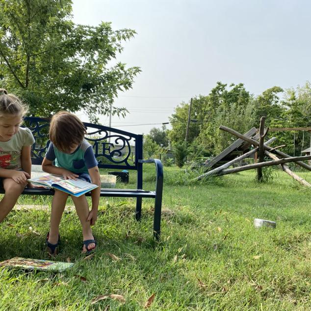 Ari and Felicity enjoying a book outside
