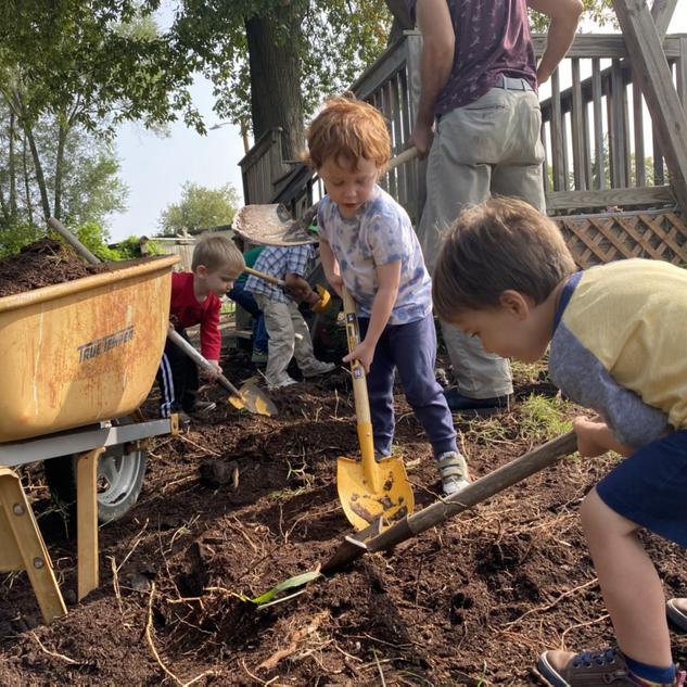 Matt had lots of helpers shoveling mulch to make room for the new sandbox