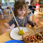 Eleanor working one of our favorite fine motor skill activities. We usually use skewers or spaghetti noodles to stick straight out of playdough and let child take beads of various sizes and place them individually on the skewers until each one is filled up.