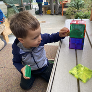 Charlie building compartments to store things
