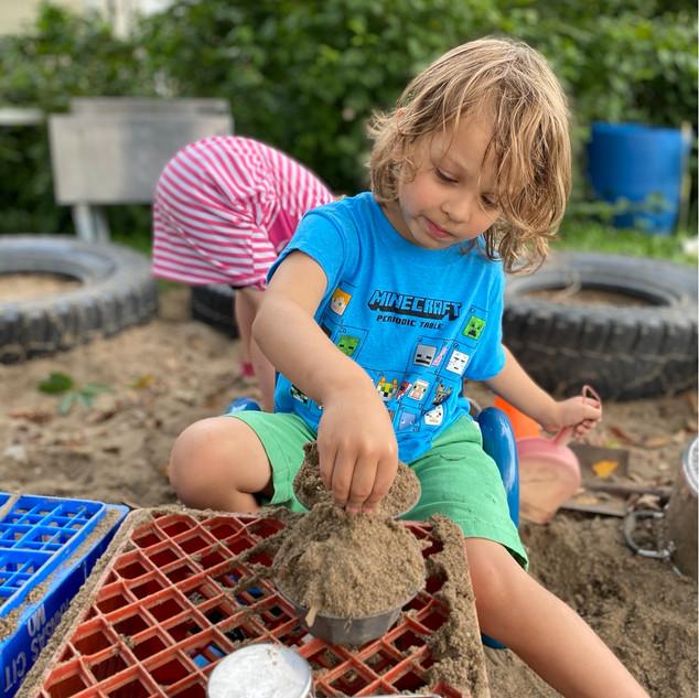 Luke cooking in the sandbox