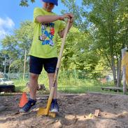 John digging in the sandbox