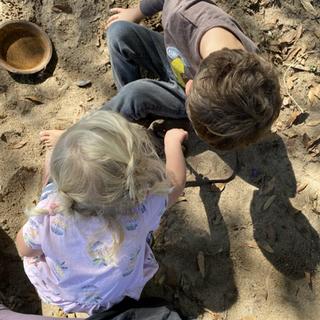 Naomi and Elon in the sandbox