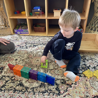 Clyde using magnetiles to make this pattern. This play is considered early forms of math