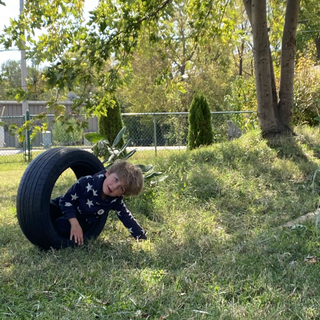 Emil was trying so diligently to fit his whole person inside this tire