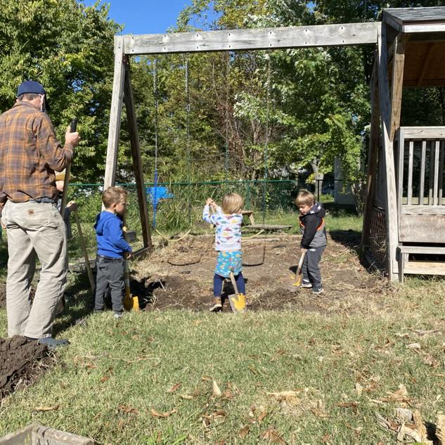 Odin, Emil, Nico, and Hazel were helping Matt dig out grass to evenutally put a sandbox here!