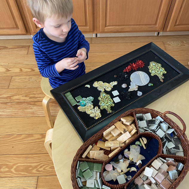 Clyde working on a small loose parts provocation